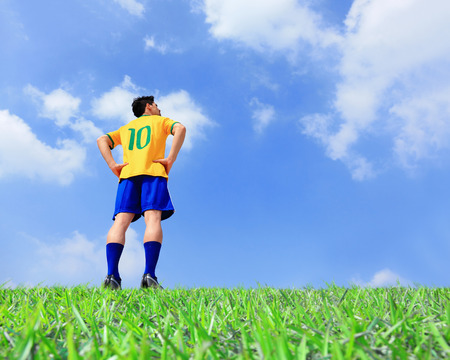 Brazil soccer player man at the stadium with blue sky photo