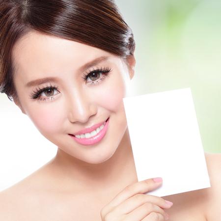 Beauty Skin care woman showing white billboard  photo