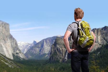 Travel in Yosemite Park, man Hiker with backpack enjoying view, California, USA, caucasian photo