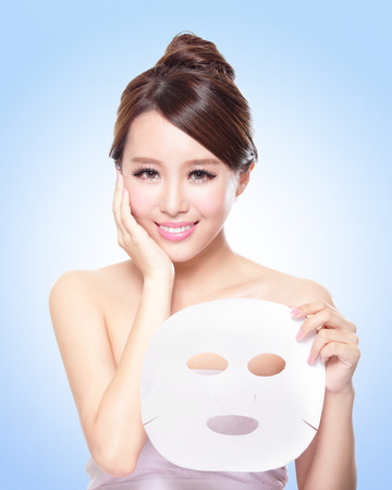 happy Young woman with cloth facial mask  photo