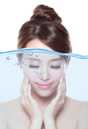 Portrait of beautiful woman with young clean skin under the water , skin care and moisturizer concept, asian Banco de Imagens