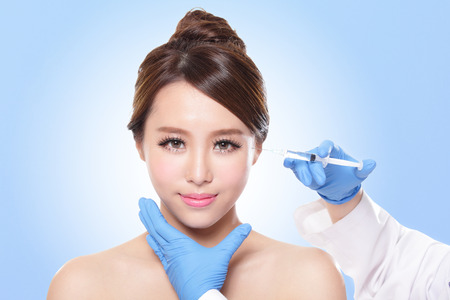 Close up of cosmetic injection to the pretty woman face. photo