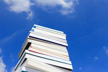Stack Of Books Against Blue Sky Stock Photo