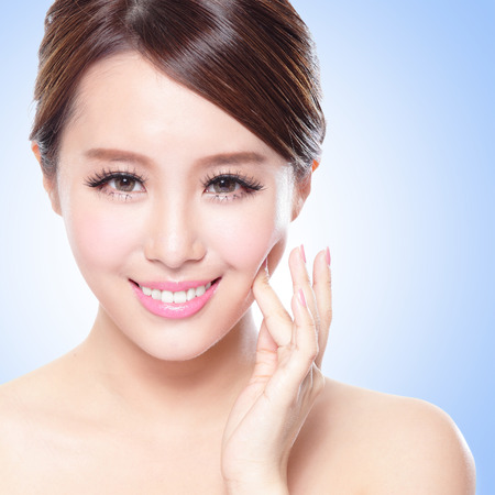 close up of attractive Skin care woman face with blue background, asian