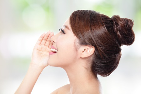 human voice: attractive woman with health skin and teeth, she is happy talk to you with nature green background, asian
