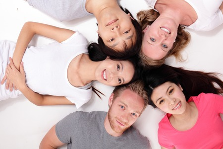 Happy Group of friends lying and making a circle, asian and caucasian photo