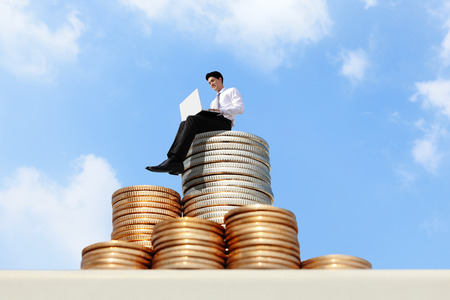 growth in economy: Successful business man working on growth money stairs coin with sky