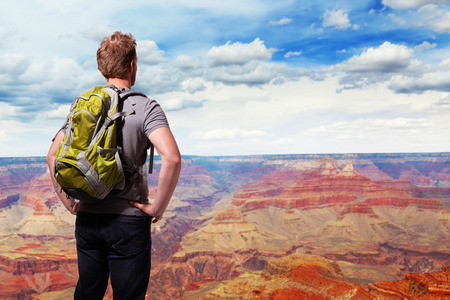 Travel in Grand Canyon , man Hiker with backpack enjoying view, USA, caucasian photo