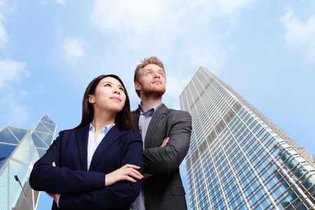 Portrait of young business people looking to the future with\ city background