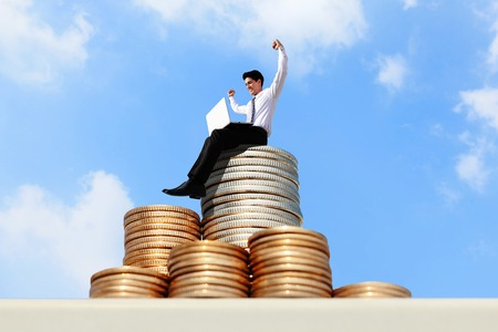 Successful business man working on growth money stairs coin with sky photo