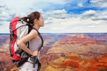 Woman mountain Hiker with backpack enjoy view in grand canyon, asian photo