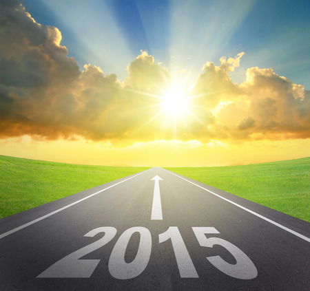 Forward to 2015 new year concept , asphalt road with arrow , date and beautiful sunset and sunshine photo