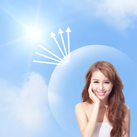 Beautiful woman face with sunshine and blue sky, concept for skin care and sun block, asian beauty photo