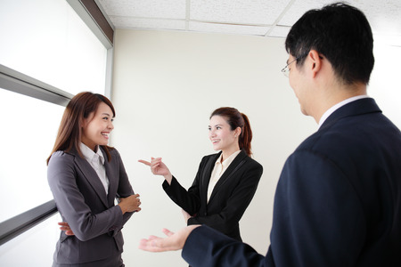 workmate: smile business team speak to her workmate office, asian