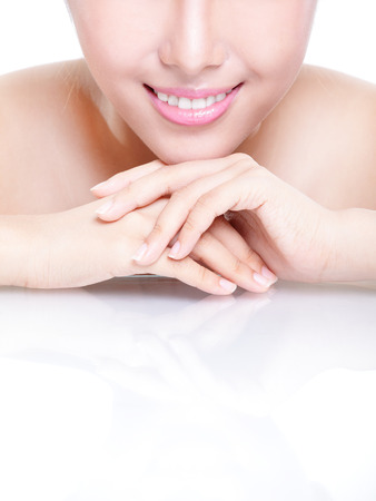 chinese face: Beautiful young woman health teeth and smile close up with copy space. Isolated over white background, asian beauty