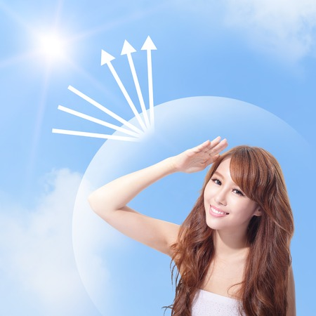 sun protection: Beautiful woman face with sunshine and blue sky, concept for skin care and sun block, asian beauty Stock Photo