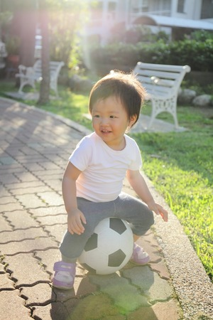 Happy child with soccer, asian photo