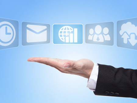 show time: Success Global business concept, business man hand palm holding all kinds of icon about Success Global business Stock Photo