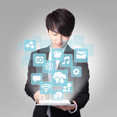 Social media concept - Business man touch digital tablet pc with APP icon interface screen, asian photo