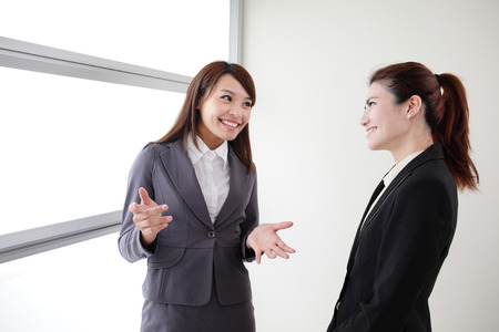 workmate: smile business woman team speak to her workmate office, asian