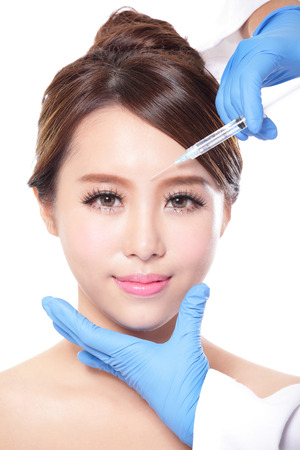 Close up of cosmetic injection to the pretty woman face. Isolated on white background, asian Stock Photo