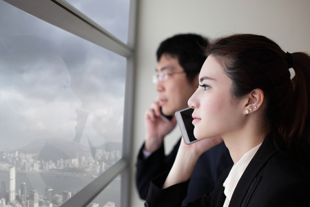 Business team speaking phone and looking through window with city background  with serious face, asia, hong kong, asian photo
