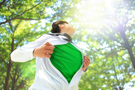 ECO concept - Business man opens his shirt to show off his green copy space in forest trees photo