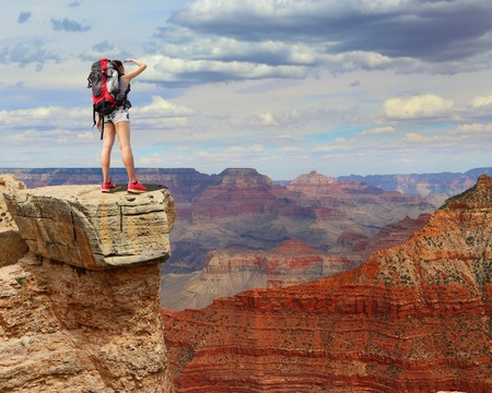 backpackers: Woman mountain Hiker with backpack enjoy view in grand canyon, asian