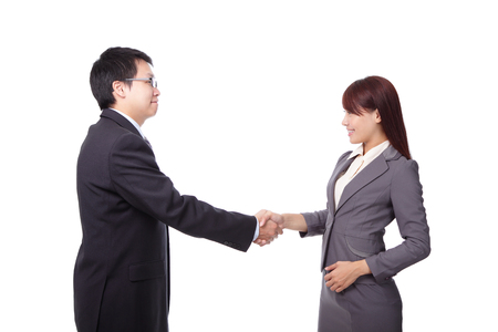 Business woman and man smiling and doing a handshake isolated on white background, asian photo