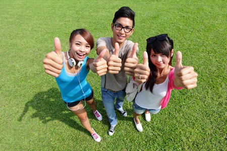 happy students in campus showing sign ok thumb, asian