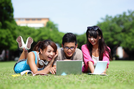 Happy College students using laptop and tablet pc on campus lawn, asian 版權商用圖片 - 30443644