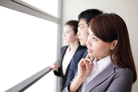 Business team look through window with think face, empty window copy space is great for your design, asian photo