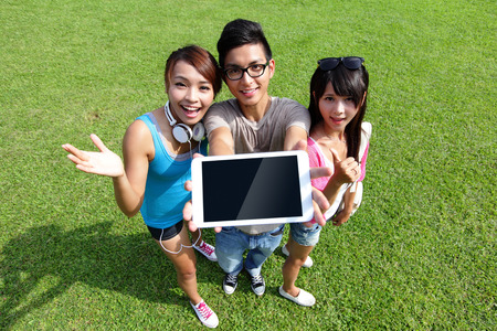 happy students in campus show digital tablet, asian photo