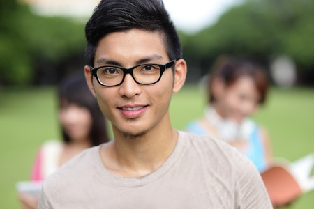 Happy College students smile to you on campus lawn, asian photo