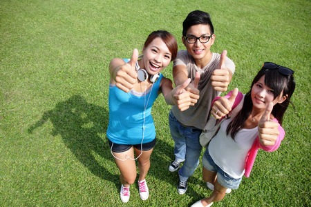 happy students in campus showing sign thumb up, asian