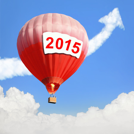 New Year concept - Hot Air Balloon with 2015 year big billboard and arrow cloud with blue sky background photo