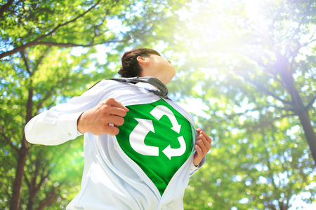 ECO concept - Business man opens his shirt to show off recycle mark in forest trees, asian Standard-Bild