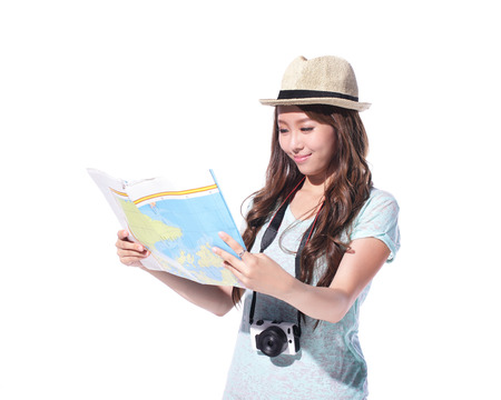 Happy woman tourist travel holding camera and map isolated on white background, asian photo