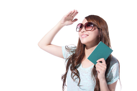 Happy woman tourist travel holding passport look to copy space isolated on white background, asian photo