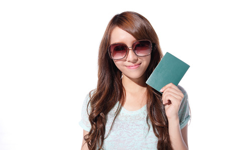 Happy woman tourist travel holding passport isolated on white background, asian photo