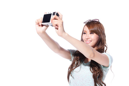 Happy travel young girl selfie taking pictures of herself isolated over white background, asian photo