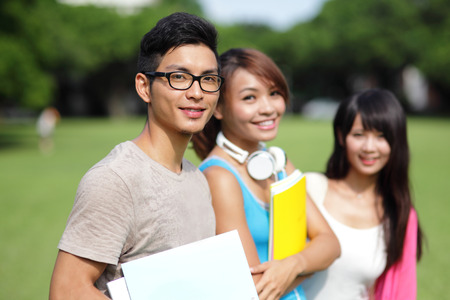 Happy College students smile to you on campus, asian photo