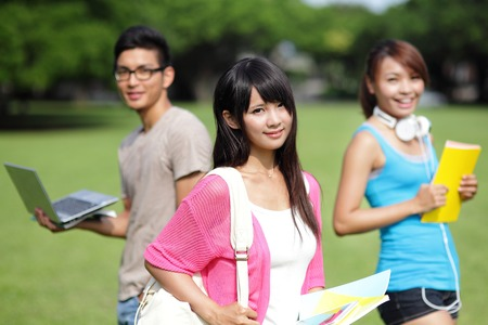 Happy girl College students smile to you on campus lawn, asian photo