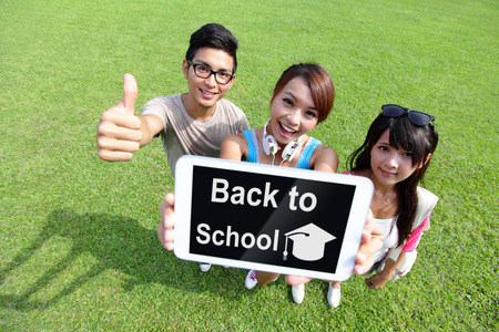 Back to School - happy students in campus show digital tablet, asian photo
