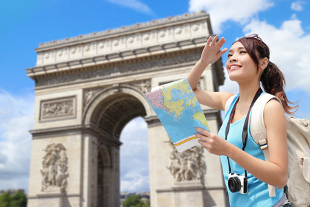triomphe: Happy woman travel in Paris, Arc de Triomphe , she look map with sky background Stock Photo