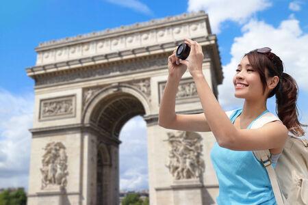 triumphe: Happy woman travel in Paris, Arc de Triomphe , she take photo by camera Stock Photo