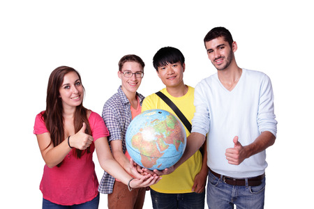 asian youth: Smile group of happy exchange students with a terrestrial globe isolated on white background, caucasian and asian Stock Photo