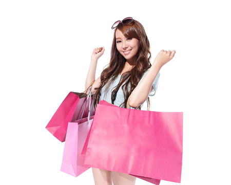 Happy Shopping - beautiful young woman holding colored shopping bags isolated on white background, asian photo