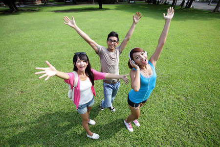 school friends: Carefree Happy College students and smile to you on campus lawn, asian