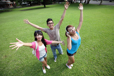 arise: Carefree Happy College students and smile to you on campus lawn, asian